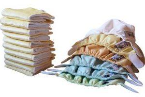 Zestaw 6 pieluszek, 10 wkładów Newborn – pastele